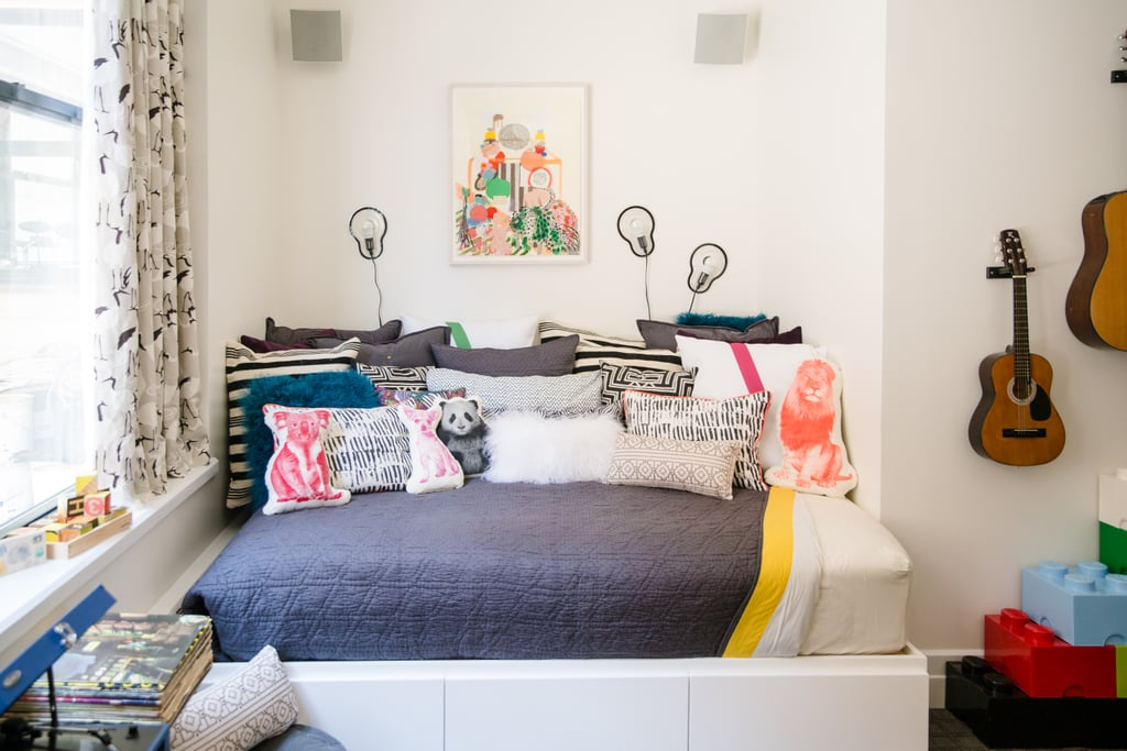 Fauna's Mini Organic Cotton Panda Cushion ($30) and Organic Cotton Koala Pillow ($33) can be found among the throw pillows on the bed, while three Sticky Lamps for Droog ($47 each) add some light (and dimension) to the wall behind the bed.