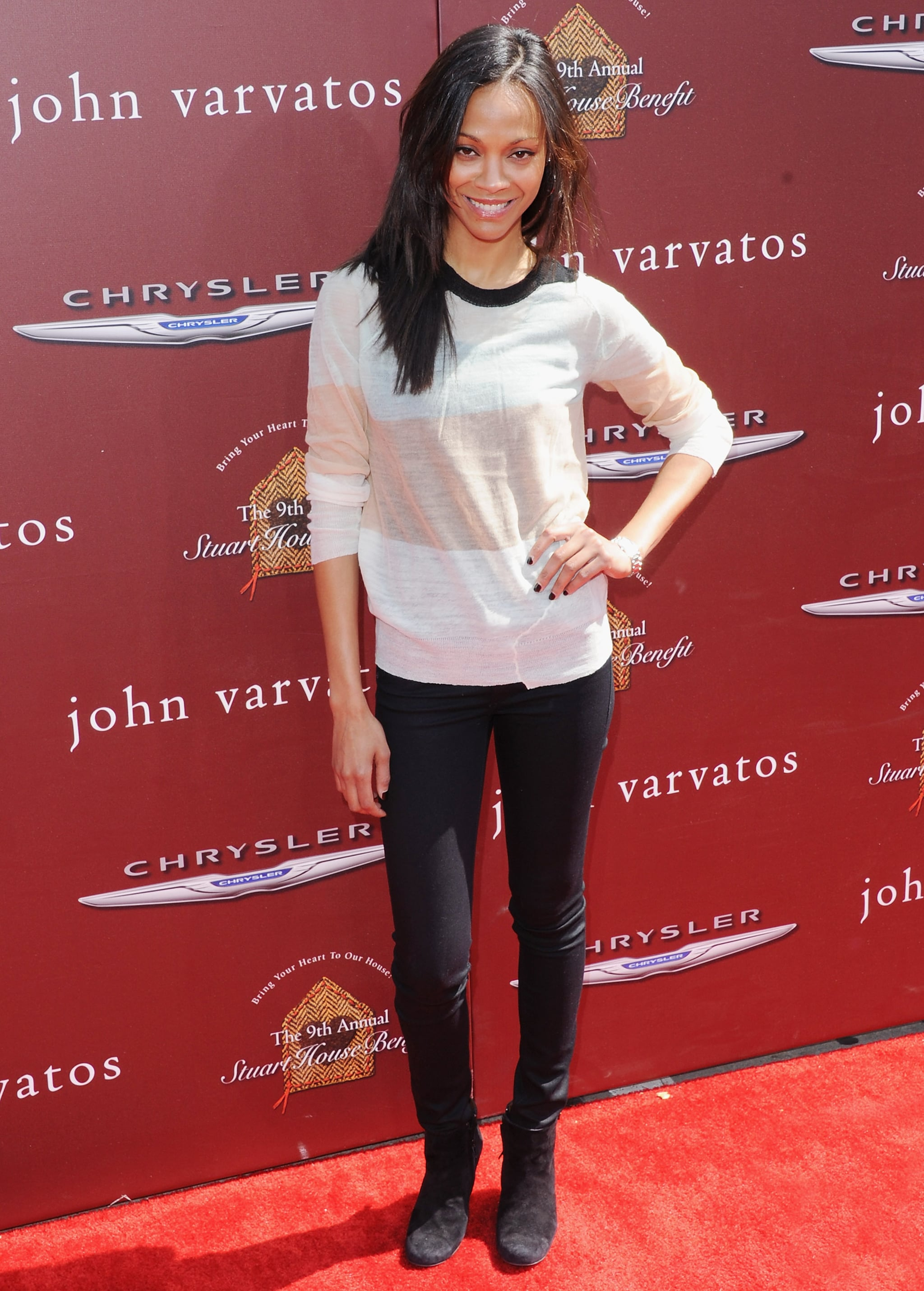 Showing off her casual sense of style, Zoe stepped out in a semisheer striped A.L.C. sweater with black skinny jeans and black boots at the John Varvatos ninth annual Stuart House benefit in 2012.