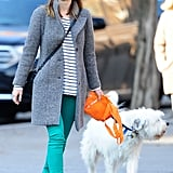 Green denim is a trendy way to get in on the St. Paddy's Day fun. Give yours a classic spin via a striped top just like Olivia Wilde did while walking her dog in NYC.