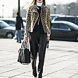 Joanna Hillman was ultrachic in a striking leopard-print jacket, leather trousers, and her signature red lip. Source: Le 21ème | Adam Katz Sinding