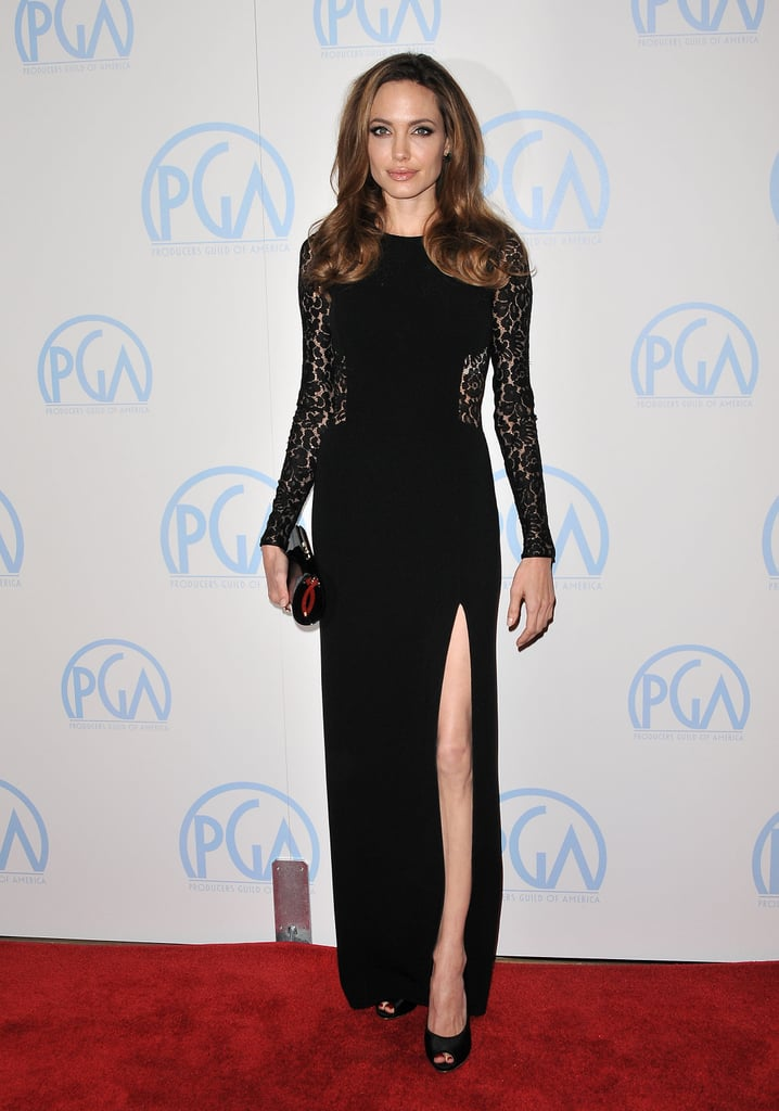 Angelina kept things covered up — apart from a thigh high split — for the Annual Producers Guild Awards in January of 2012 in this black lace Michael Kors design.