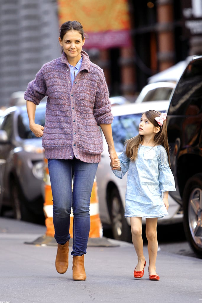 Katie Holmes held hands with Suri Cruise while out in NYC yesterday. Their weekend together came after an exciting week comprised of firsts for the mother-daughter duo. Suri started school last Tuesday, while mom Katie had a debut of her own. Last Thursday, Katie showed her line, Holmes & Yang, for the first time ever during New York Fashion Week. While Katie and Suri celebrated in the Big Apple, Suri's dad, Tom Cruise, spent time across the pond. Tom was spotted leaving an office building in London, where he is currently working on his latest project, All You Need Is Kill, Friday.