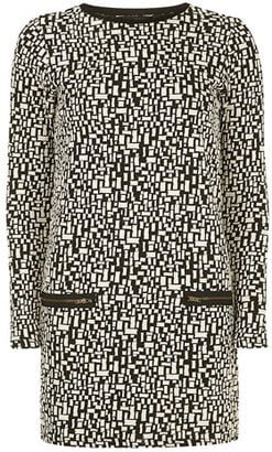 Dorothy Perkins's ivory check jacquard knit tunic ($44) is the perfect way to nail the chic black-and-white look.