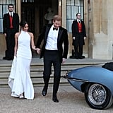 To imitate this Meghan and Harry look for Halloween, you'll most notably need a floor-length white gown and snappy black tuxedo. Worried your fellow Halloween partygoers won't recognize you as the royal newlyweds? Try arriving to the festivities in a light-blue car like the one they drove in. That'll really sell it!