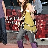 In 2008, Miley wore a chartreuse chiffon dress over charcoal jeans with purple boots for an appearance at the City of Hope benefit concert in California.
