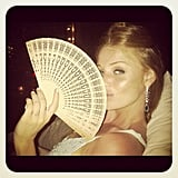 Cintia Dicker looked chic with a fan. Source: Instagram user cintiadicker
