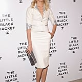 Karolina Kurkova opted for chic Spring suiting, in a white skirt suit with silver-metallic trim — but we can hardly take our eyes off her feather-and-pearl-embellished sandals.