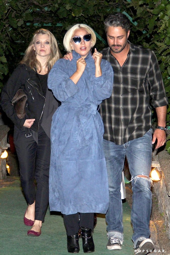 Lady Gaga's handsome fiancé, Taylor Kinney, kept his arm around her during the couple's dinner date with Game of Thrones star Natalie Dormer in Serbia on Wednesday. The pop star made her way to Belgrade, where Taylor and Natalie are busy shooting a thriller movie, The Forest. Taylor and Lady Gaga had their arms around each other as they left the restaurant, adding to their list of cute moments together.  Taylor popped the question to Lady Gaga on Valentine's Day of this year, proposing to the singer with a gorgeous, heart-shaped ring. Since then, he's shared sweet details about the proposal, and Lady Gaga dished on what she's looking for in a wedding dress. Keep reading for more pictures of the pair's night out with Natalie, then check out some of Taylor's hottest moments on Chicago Fire.