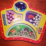 Use a cupcake tin, ice tray, or kid plate to lay out small craft supplies.
