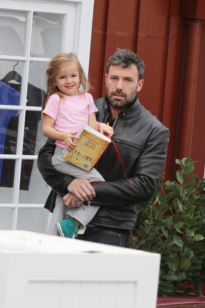 Ben Affleck took his daughter Seraphina to a breakfast date in LA this morning after dropping his oldest, Violet, off at school. Seraphina brought along a book, Illustrated Stories From Dickens, for the outing to their usual haunt, the Brentwood Country Mart. Ben has taken on dad duty since Jennifer Garner headed out of town earlier this week. On Tuesday, Jen caught a flight out of LAX and she, too, showed off her reading material, The Heart and the Fist: The Education of a Humanitarian, the Making of a Navy SEAL. Ever since wrapping his Argo tour with premieres in both the US and overseas, Ben has been making up for lost time with his little ones. Over the weekend, Ben, Seraphina, and Violet made a trip to the farmers market together.