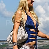 Paris Hilton took in the sights in a blue bathing suit at Bondi Beach in Australia.
