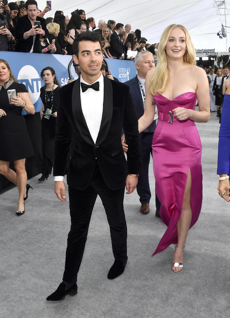 "Sophie Turner had the support of husband Joe Jonas as she attended the SAG Awards on Sunday night. After channelling their inner Danny and Sandy in the Jonas Brothers music video for ""What a Man Gotta Do,"" the couple was all smiles as they walked arm-in-arm on the red carpet together. While Joe looked dapper in a suit and bow tie, the Game of Thrones actress, whose series is up for outstanding performance by an ensemble in a drama series, looked pretty in pink as she sported a strapless gown. Perhaps she was going for Marilyn Monroe in the 1953 classic Gentlemen Prefer Blondes this time around? One thing is for sure, we're suckers for this couple. See more pictures of their date night ahead."