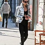 For the gym, Bella chose a black pair of Nike shoes to go with her Tommy Jeans puffer jacket.