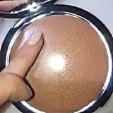 Laura Mercier Bronzed Butter Face and Body Veil in Gold Lus