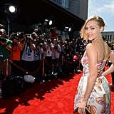 The Carrie Diaries star AnnaSophia Robb flashed an over-the-shoulder grin on the Young Hollywood Awards red carpet.