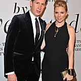 Sienna Miller and Stefano Tonchi posed together.