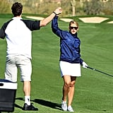 Lo Bosworth celebrated a great shot with a friend during a February 2010 round of golf in Arizona.