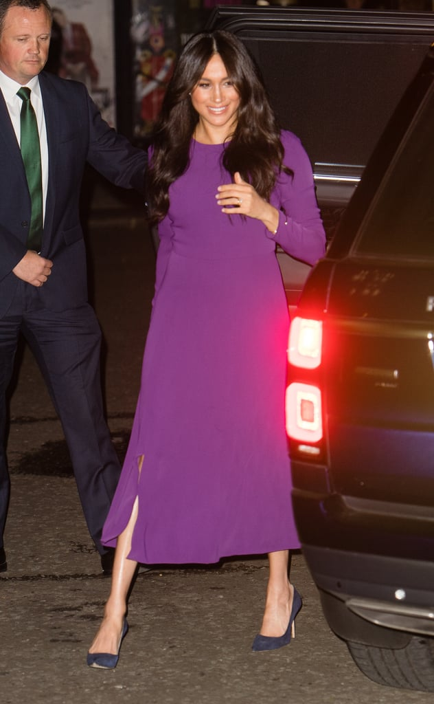 Meghan Markle made an appearance at the One Young World Summit on Tuesday evening, and she picked a favorite dress for the special event. The Duchess of Sussex looked regal as ever when she rewore Aritiza's Babaton Maxwell Dress — the same number she wore in January when she was still pregnant with Archie.  At the beginning of the year, Meghan and Prince Harry stepped out for a number of events in Birkenhead, England. Meghan turned heads in her colorful ensemble, as she paired the Aritzia piece with a bright red belted coat by Sentaler and complementary heels.  This time around, Meghan kept things more subdued. She wore her modest midi dress with a pair of Manolo Blahnik navy pumps, and kept her accessories simple, aside from her sparkling engagement ring. Keep reading for a closer look at her whole outfit. She clearly likes to keep this dress around for important events, and we can't blame her!  Related: Meghan Markle Just Re-Wore Her Engagement Dress, Because She's a Proud Outfit Repeater