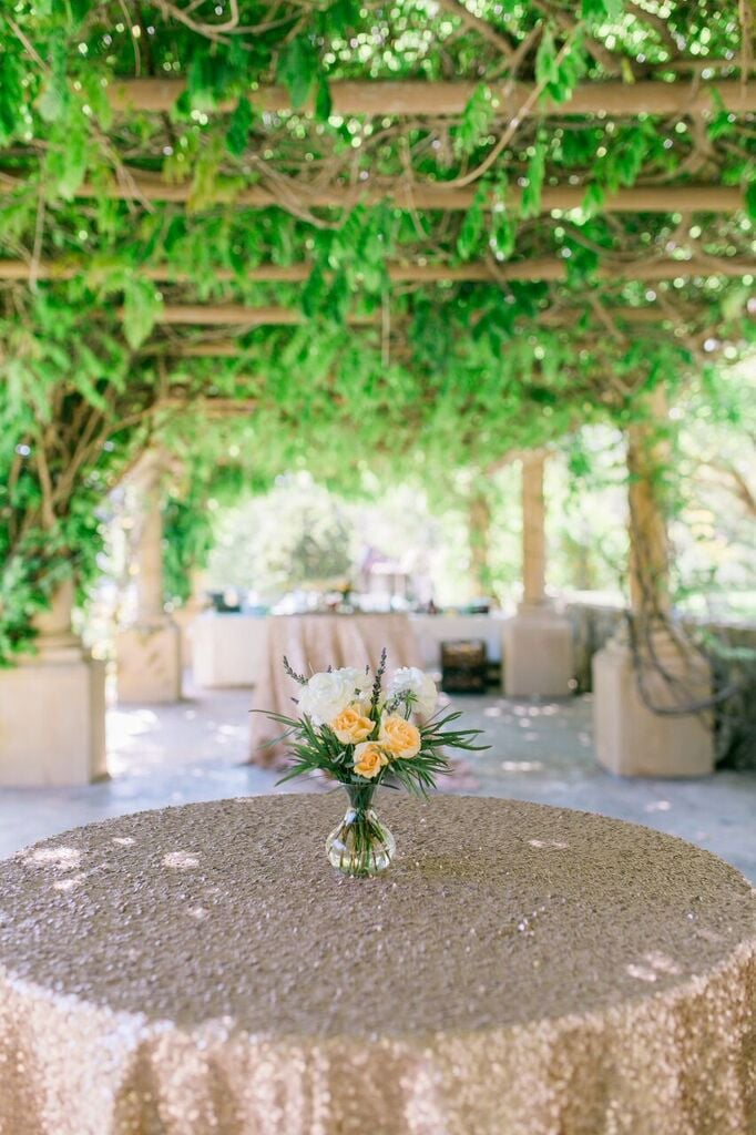 Pick floral arrangements that complement gold tablecloths.