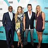 L.A. Reid, Demi Lovato, Simon Cowell, and Britney Spears posed together at the Fox Upfronts party at a skating rink in Central Park.