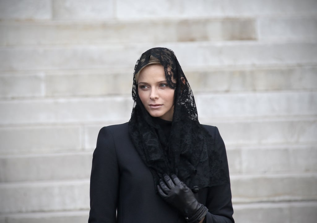 Princess Charlene wore all black as she left the Monaco Cathedral during the Sainte-Dévote festivities in January 2011. Source: Getty / Valery Hache/AFP