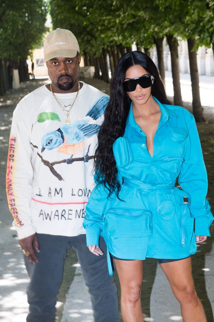 Kim Kardashian is back in Paris nearly two years after her terrifying robbery. On Thursday, the 37-year-old reality TV star and mother of three popped up at the Louis Vuitton men's show with husband Kanye West. Clad in a bright blue dress and oversize sunglasses (apparently Kanye told her tiny glasses were over), Kim appeared at ease as she posed for photos outside and shared a laugh with sister Kylie Jenner in the front row. The event also brought out several other famous faces including Rihanna, Bella Hadid, Alexander Skarsgard, Travis Scott, A$AP Rocky, and Naomi Campbell.  Kim's life was forever changed when she was robbed and held at gunpoint in her Paris hotel room while in town for Fashion Week on Oct. 2, 2016. This marks the first time Kim has returned to the city since the harrowing attack — she even skipped Fashion Week last year.