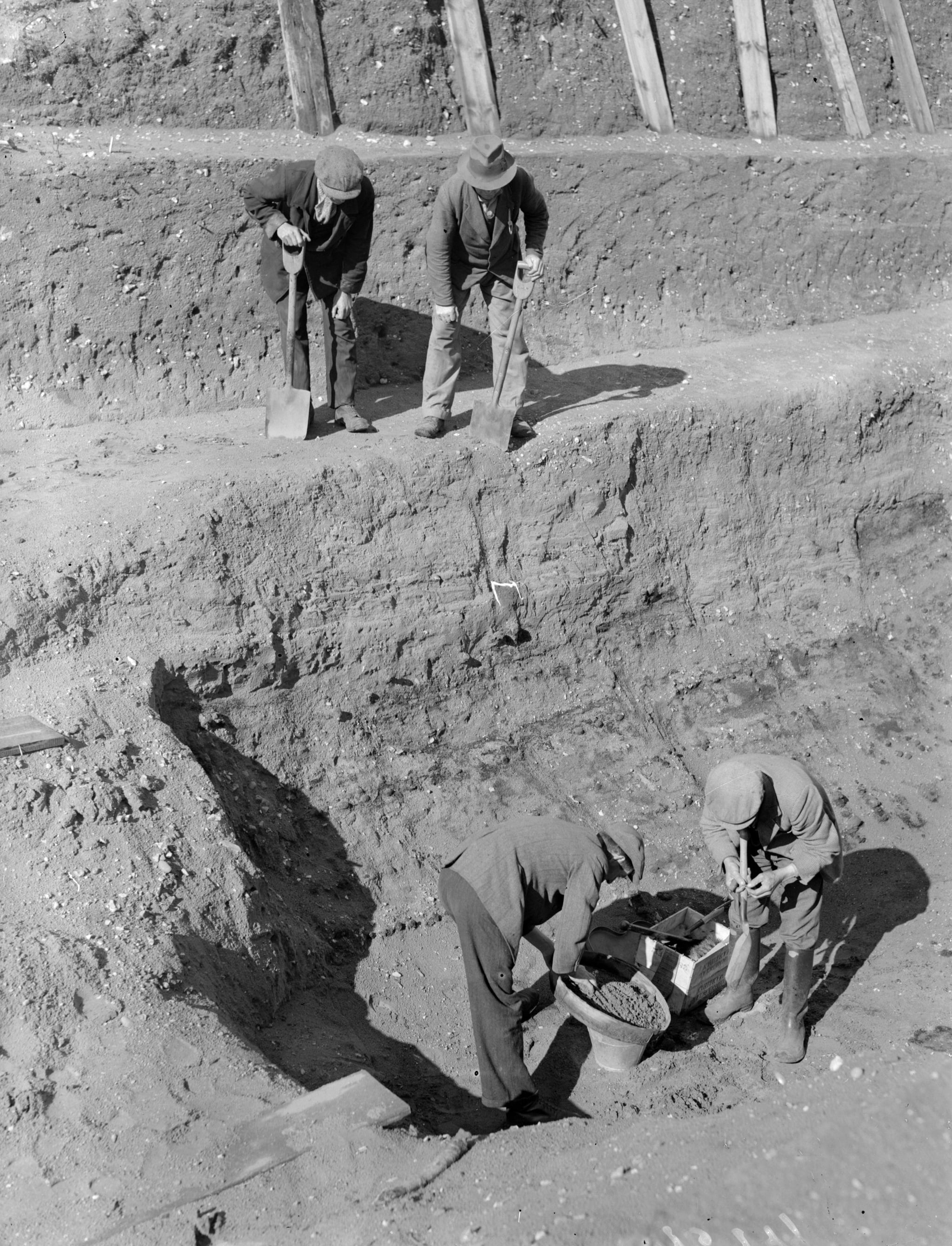 31st July 1939:  Workmen sift through earth at the bottom of the excavation of the Anglo-Saxon burial ship at Sutton Hoo, Suffolk.  (Photo by A. Cook/London Express/Getty Images)