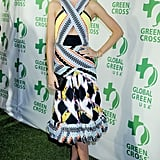 Miranda Kerr stole the limelight in a vibrant printed Peter Pilotto Spring '13 cutout dress paired with black satin pumps.