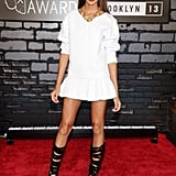 Joan Smalls paired a little white Viktor & Rolf mini-dress with black strappy Casadei sandal boots at the MTV VMAs.