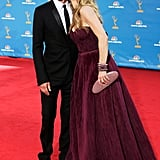Kyra gave her husband a kiss on the cheek as they walked the red carpet at the Emmy Awards in August 2010.