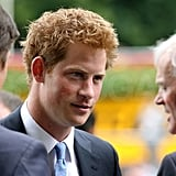Prince Harry talks at the King George Horse Race.