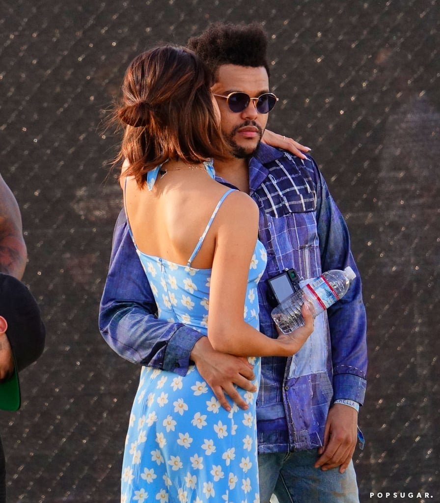 Coachella's first weekend officially kicked off on Friday, and Selena Gomez and The Weeknd were just two of the many stars who hit up the music festival to watch Travis Scott perform. The Canadian crooner and the 13 Reasons Why executive producer were spotted hanging out in the VIP area, and The Weeknd led the way for Selena as she followed close behind and held his hand. At one point, The Weeknd even wrapped his arms around Selena to protect her from the massive crowd of fans (and you thought chivalry was dead). The following day, the two were practically inseparable as they strolled the festival grounds arm in arm and shared a sweet kiss. Selena — who looked adorable in a Falling Floral dress — also commemorated the occasion by posting the first photo of her and The Weeknd on her Instagram feed.      Related:                                                                                                           The Way They Were: A Day-by-Day Look Back of Selena and The Weeknd's Whirlwind Romance               Even though Coachella's lineup was announced a few months ago, The Weeknd surprised fans when he took the stage for a performance with rapper Nav on Saturday night. While Selena didn't join him onstage, we're pretty sure she was somewhere nearby cheering him on.