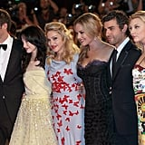 Madonna posed with her W.E. cast at the film's premiere.