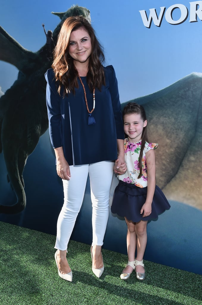 """In case you had any doubts, Tiffani Thiessen's daughter is freakin' adorable. On Monday, the former Saved by the Bell star attended the LA premiere of Disney's Pete's Dragon with her mini me, Harper. The duo appeared to be in good spirits as they smiled and posed for pictures, and we couldn't help but notice just how much little Harper looks like her famous mom. Not only did they coordinate outfits, but they also share very similar facial features. Also at the event was Bryce Dallas Howard, who we last saw in London with her dad, Ron, just a couple of weeks ago. Check out even more """"aw""""-inducing snaps of Tiffani and her family."""