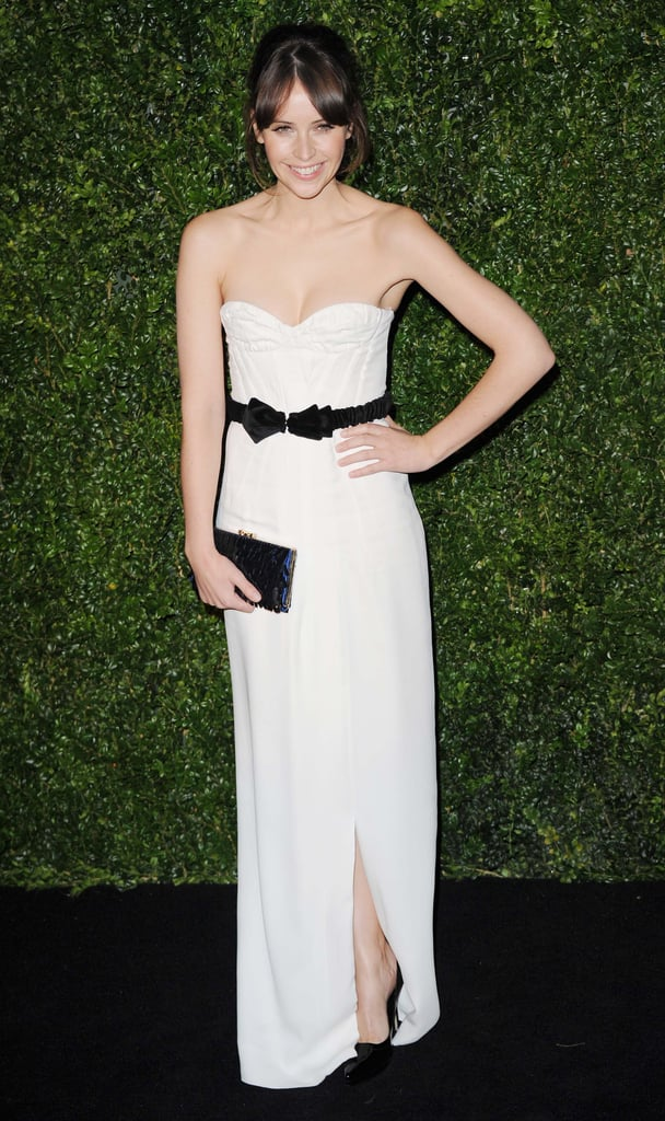 Felicity Jones showed off her sweet style in a white strapless gown by Burberry Prorsum — how cute is her bow-tie belt?