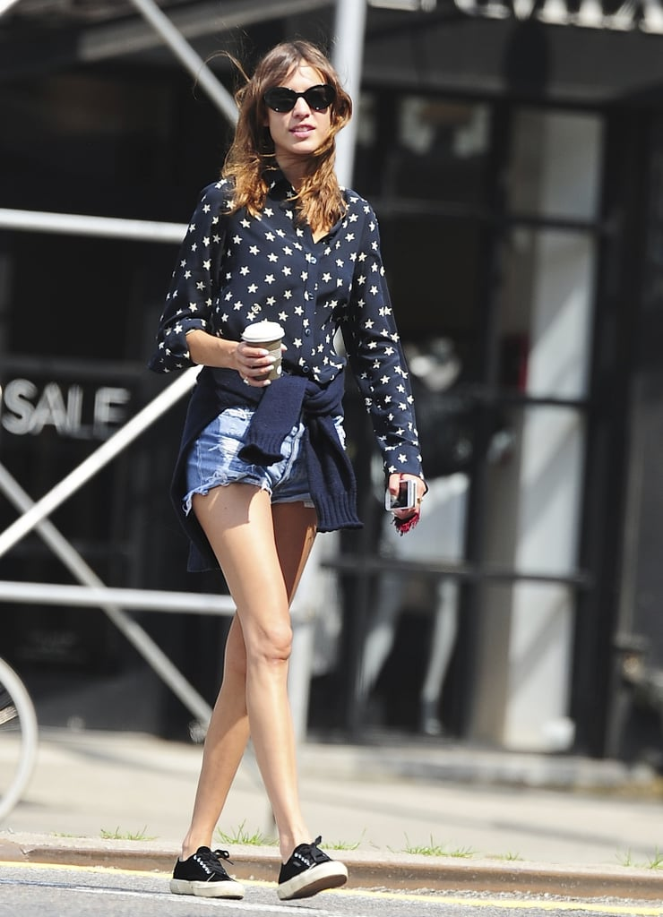 Alexa Chung managed to make her cutoffs feel preppy with a printed button-down and classic kicks.