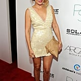 Lauren sported a pretty cream-coloured BCBG Max Azria paillette frock for an event in 2011. Lesson from Lauren: don't be afraid to mix textures.
