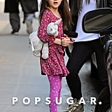Suri Cruise showed off her shorter bangs.