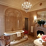 With its free-standing tub, chandelier, and marble walls, this bathroom takes glamorous to a new level!
