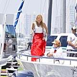 Blake pulled up her skirt to move around the yacht.