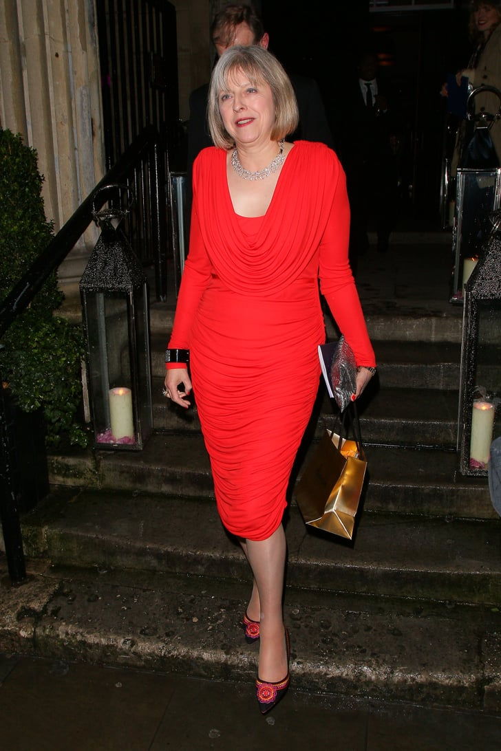 A Red Body Hugging Dress British Prime Minster Theresa