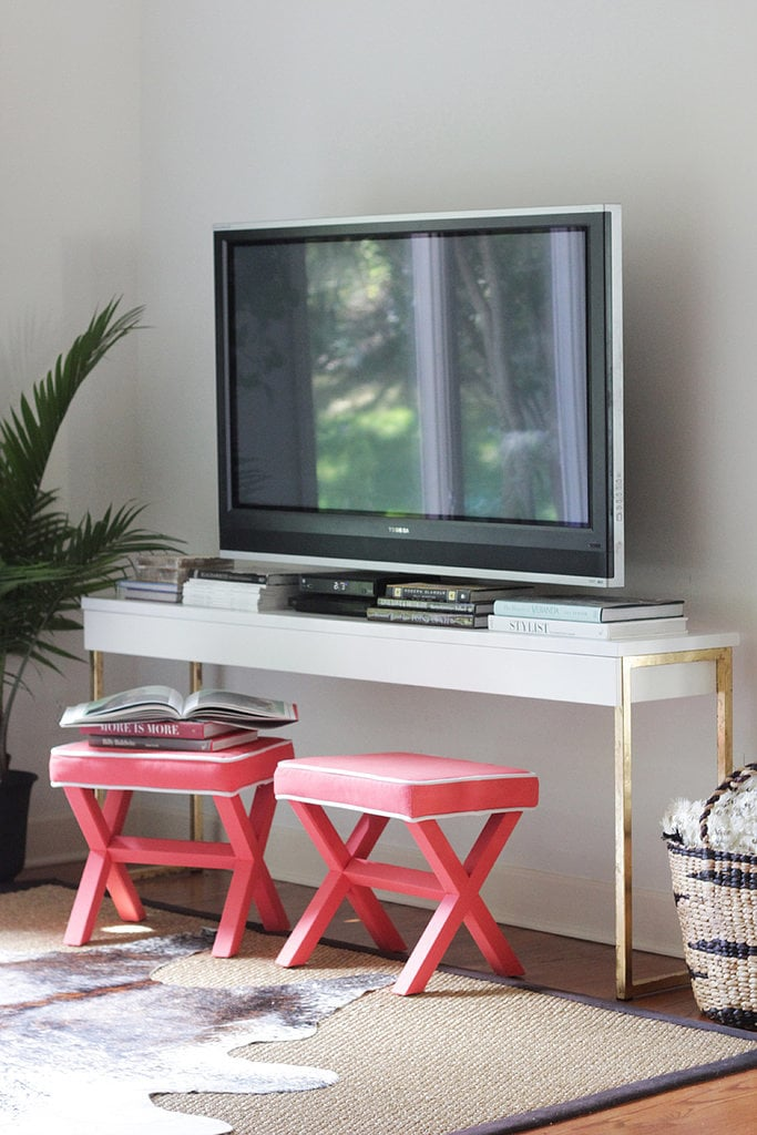 Create a glamorous TV console by adding gold leaf to an Ikea desk.