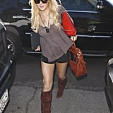 Lindsay Lohan continued to cover up her SCRAM, this time with a pair of stylish brown suede knee-high boots.