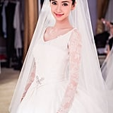 Angelababy showed off her bow brooch, which complemented her Chaumet tiara.