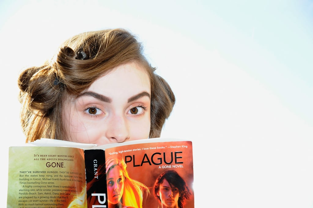 Backstage at the Nomia Spring 2013 show, a model read Michael Grant's Plague: A Gone Novel.