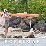 Miranda Kerr photographed her husband Orlando Bloom and son Flynn bloom taking a dip in Bora Bora.
