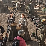 A behind-the-scenes shot of Claire and Geillis.