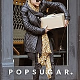 Mary-Kate Olsen walked out of a store in NYC carrying a box..