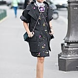Miroslava Dumo kept her whimsical street charm coming in a Chanel ensemble and rainbow platform pumps.