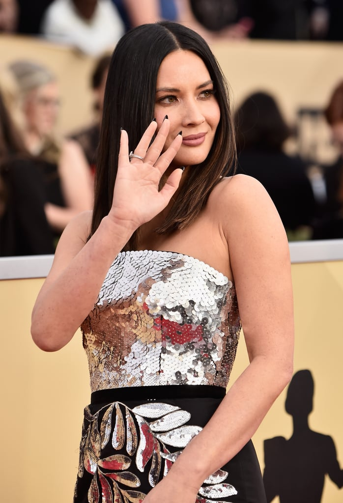 "Oprah Winfrey and Olivia Munn walk into a bathroom during a full moon. No, this isn't the beginning of some hypothetical joke — it's an actual anecdote Olivia graciously shared while walking the 2018 SAG Awards red carpet.  In an interview with E! News, the 37-year-old actress said she recently bumped into Oprah in the bathroom of the Soho House. As Olivia looked up at her reflection while washing her hands, Oprah casually said, ""Oh, it's a full moon,"" as one does. Olivia replied, ""You know what — they say during full moons crazy things happen and it's funny 'cause all my friends are breaking up lately so maybe that has something to do with it."" Oprah replied, ""No, it's not a full moon. Your friends are just breaking up."" Though a brutally honest take, Olivia didn't seem to mind considering it was from freaking Oprah — and neither would we.  A few hours before arriving at the SAG Awards, Olivia cleared up rumors that she was dating Chris Pratt and even shared a screenshot of her text exchange with Anna Faris. See pictures from her latest red carpet appearance ahead."